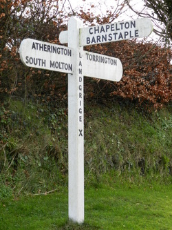 Holiday Cottages in North Devon , Traditional signpost opposite our holiday cottages.